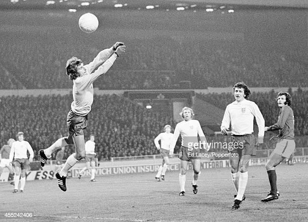 England goalkeeper Ray Clemence saves watched by teammates Bobby Moore and Roy McFarland and John Toshack of Wales during their World Cup Qualifying...