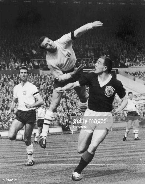 England goalkeeper Ron Springett punches the ball clear in the opening minutes of a Soccer International match against Scotland at Wembley Stadium...