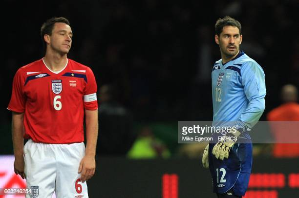 England goalkeeper Scott Carson and John Terry stand dejected after Germany's Patrick Helmes scores his sides first goal of the game