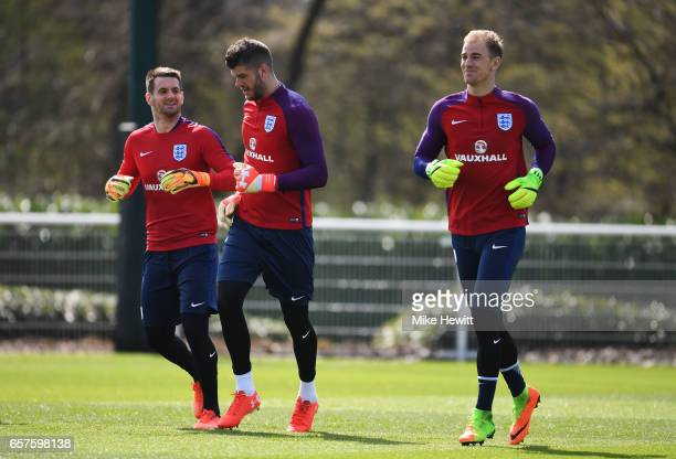 England goalkeepers Tom Heaton Fraser Forster and Joe Hart warm up during the England training session at the Tottenham Hotspur Training Centre on...