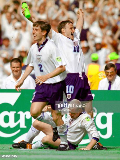 England goalscorer Paul Gascoigne after his 'Dentists Chair' celebration with Teddy Sherringham and Gary Neville during the 1996 European...