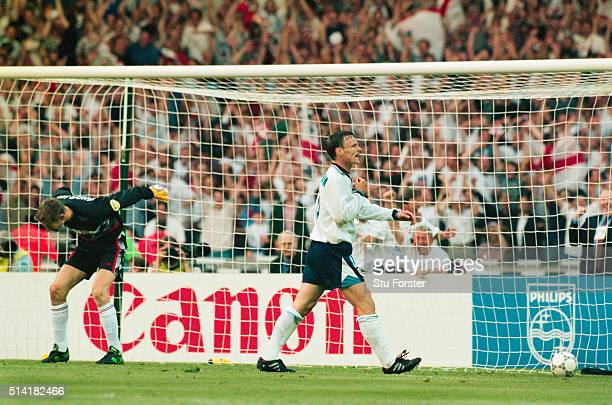 England goalscorer Teddy Sheringham celebrates after he had scored the second goal past Dutch goalkeeper Edwin van der Sar during the 1996 European...