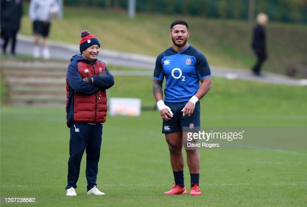 England Head Coach, Eddie Jones and Manu Tuilagi look on during an England training session at Pennyhill Park on February 19, 2020 in Bagshot,...