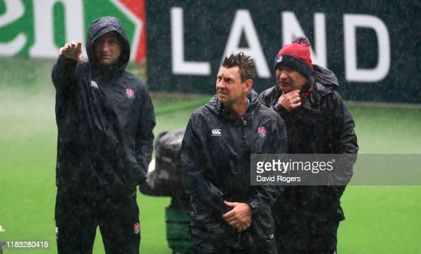 England head coach Eddie Jones looks on with Scott Wisemantel the England attack coach and forwards coach Steve Borthwick during the England...