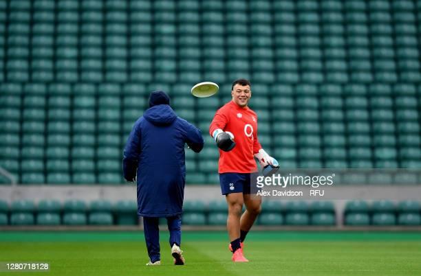 England Head Coach Eddie Jones plays frisbee with Ellis Genge of England during an England rugby training session at Twickenham Stadium on October 17...