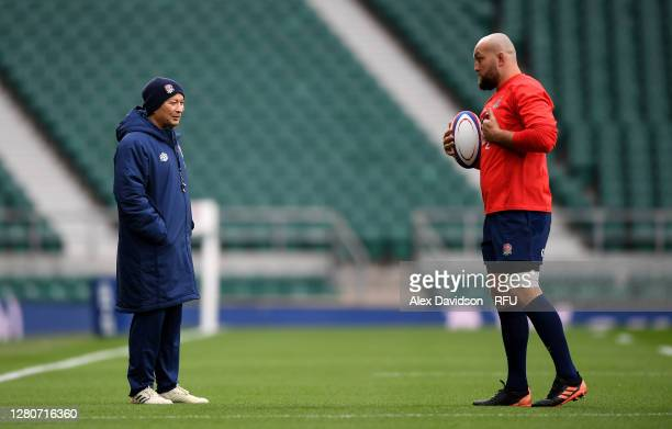 England Head Coach Eddie Jones talks to Tom Dunn of England during an England rugby training session at Twickenham Stadium on October 17 2020 in...