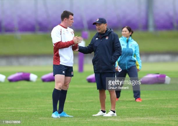 England Head Coach Eddie Jones talks with Ben Spencer during a training session at Fuchu Asahi Football Park on October 29, 2019 in Fuchu, Tokyo,...