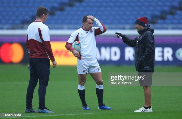 England head coach Eddie Jones talks with players George Ford and Owen Farrell during the Captain's Run at International Stadium Yokohama on October...