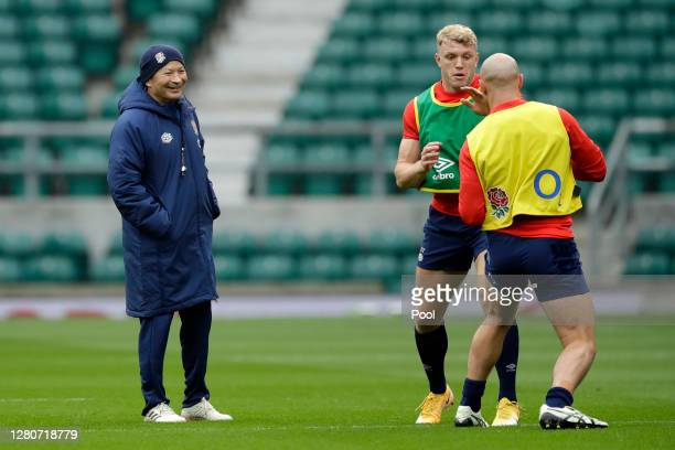 England head coach Eddie Jones watches on as Ollie Thorley and Willi Heinz of England interact during an England rugby training session at Twickenham...