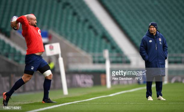 England Head Coach Eddie Jones watches Tom Dunn of England during an England rugby training session at Twickenham Stadium on October 17 2020 in...