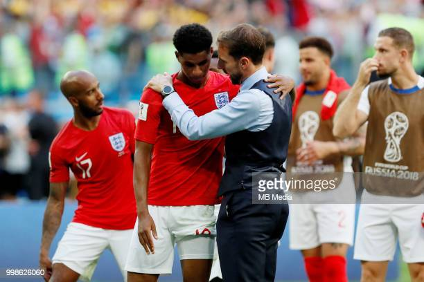 England head coach Gareth Southgate talks to Marcus Rashford after the 2018 FIFA World Cup Russia 3rd Place Playoff match between Belgium and England...