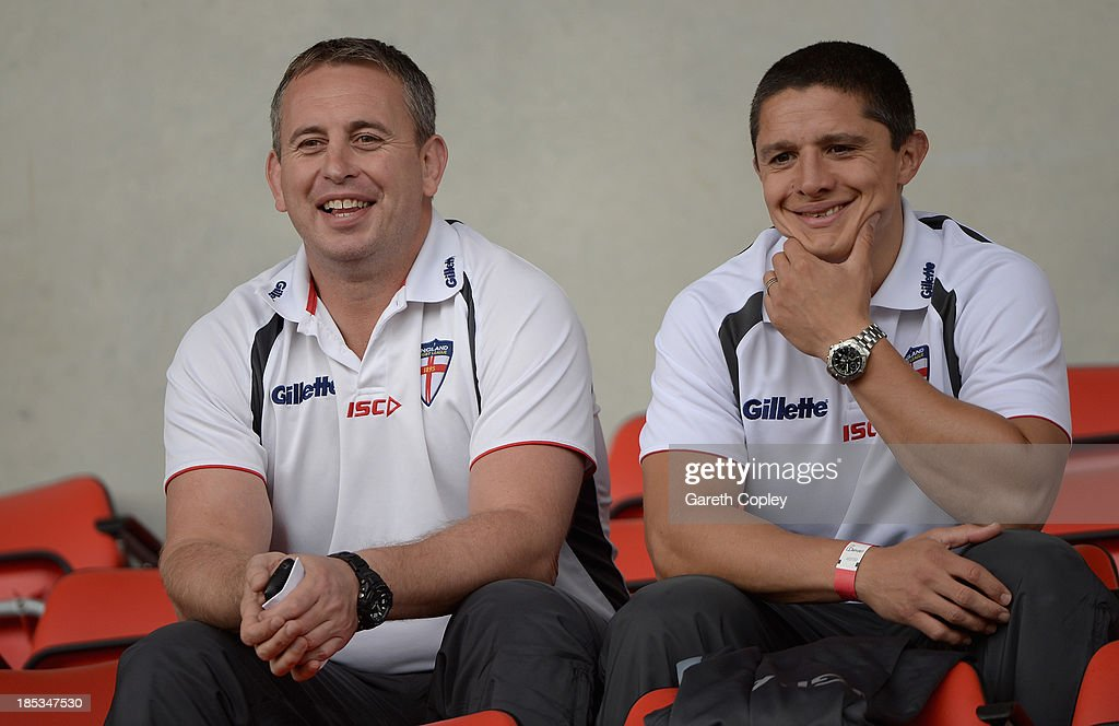 England head coach Steve McNamara and assistant coach Paul Deacon watches the International match between England Knights and Samoa at Salford City Stadium on October 19, 2013 in Salford, England.