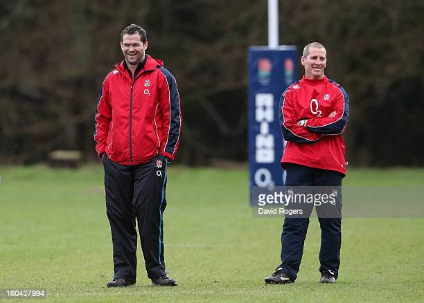 England head coach Stuart Lancaster laughs with backs coach Andy Farrell during an England training session at Pennyhill Park on January 31 2013 in...