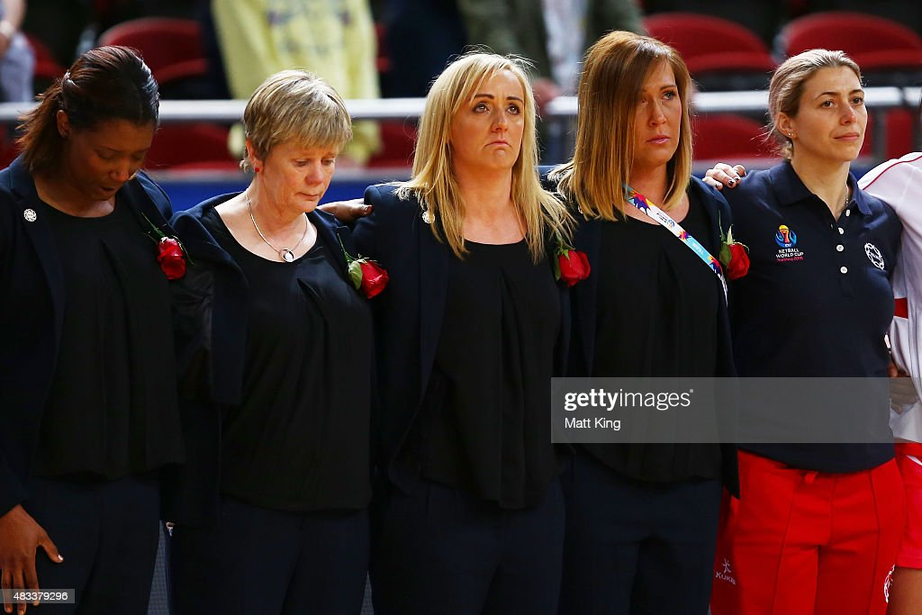 England head coach Tracey Neville (C) looks on while a moment silence is observed following the death of her father Neville Neville during the 2015 Netball World Cup match between England and Jamaica at Allphones Arena on August 8, 2015 in Sydney, Australia.