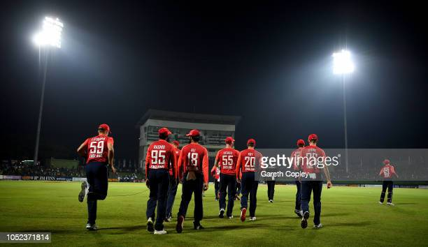 England head on to the field ahead of the 3rd One Day International match between Sri Lanka and England at Pallekele Cricket Stadium on October 17...