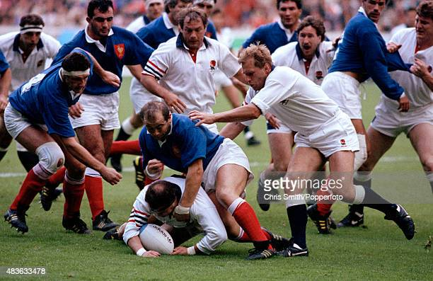 England hooker Brian Moore falls on the ball ahead of Philippe Marocco of France with Jeff Probyn and Peter Winterbottom in support during the Rugby...