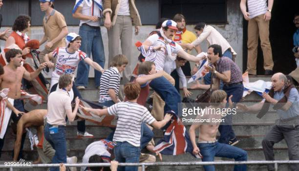 England Hooligans fighting on the terraces during the UEFA Euro 1980 group match between Belgium and England at the Stadio Comunale on June 12 1980...