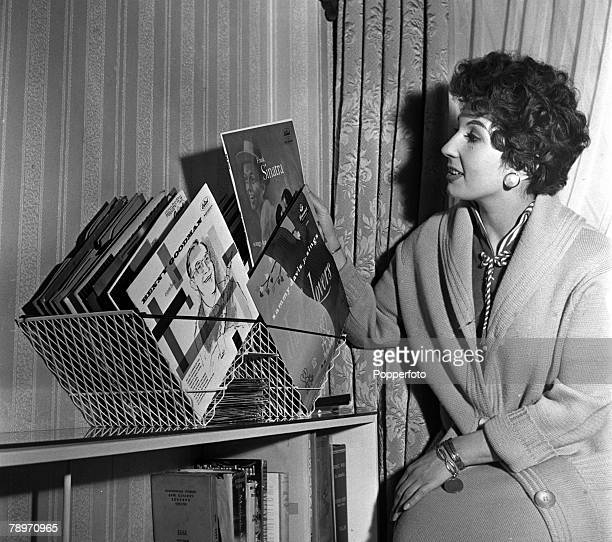 England House gadgets made and used by stars and personalities Singer Alma Cogan is pictured with her record collection contained in a shopping basket