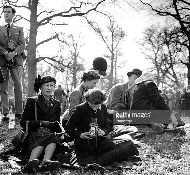 England HRH Princess Margaret adjusts her cine camera at the Olympic horse trials at Badminton with group captain Peter Townsend behind