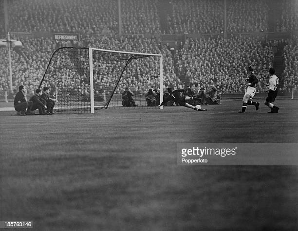 England insideleft Jackie Sewell puts the ball past Hungarian goalkeeper Gyula Grosics to equalize the score at 11 in the 13th minute of an England...
