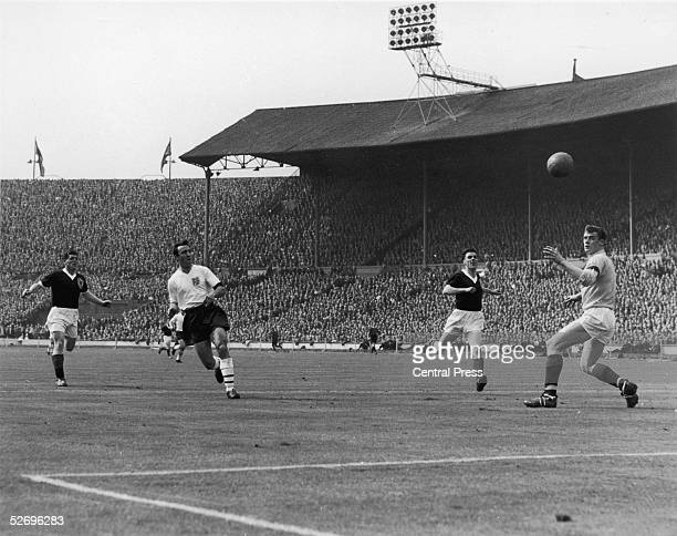 England insideright Jimmy Greaves takes a shot at goal past goalkeeper Francis Haffey during the EnglandScotland match at Wembley 15th April 1961...