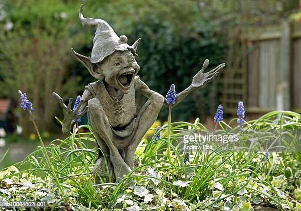 UK, England, Isabel's Goblin sculpture by David Goode in suburban garden