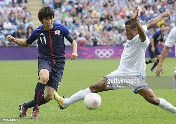 COVENTRY England Japan's Kensuke Nagai passes the ball during the second half of a men's soccer Group D match against Honduras at the City of...