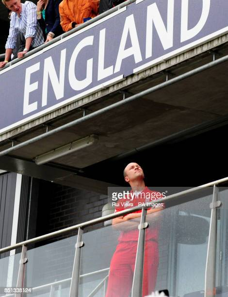 England' Jonathan Trott checks the weather from the players balcony as rain delays play during the ICC Champions Trophy Final at Edgbaston Birmingham
