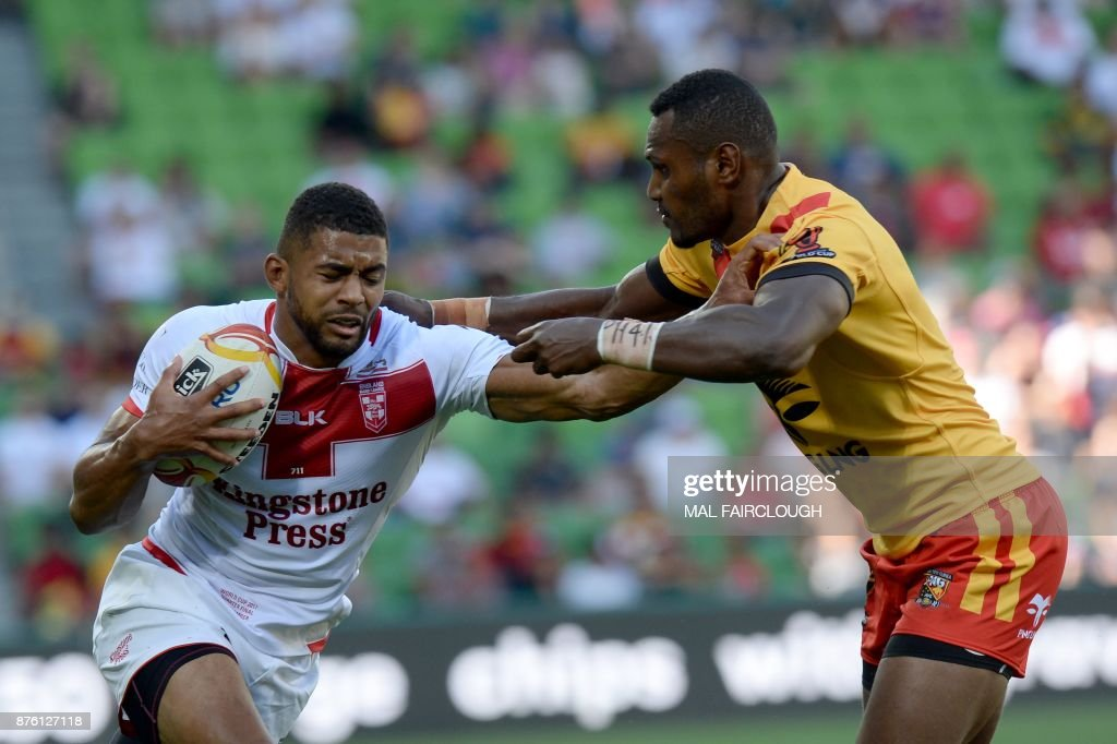 England Kallum Watkins (L) is tackled by Kato Ottio of Papua New Guinea during their Rugby League World Cup quarter-final match between England and Papua New Guinea in Melbourne on November 19, 2017. / AFP PHOTO / Mal Fairclough / IMAGE