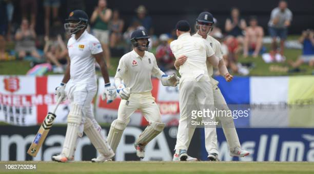 England keeper Ben Foakes and Ben Stokes congratulate Keaton Jennings who had deflected a shot by Sri Lanka batsman Dimuth Karunaratne to be caught...