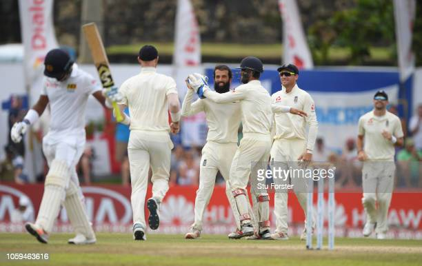 England keeper Ben Foakes celebrates with bowler Moeen Ali after Ali had caught and bowled Sri Lanka batsman Dimuth Karunaratne during Day Four of...