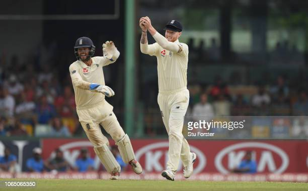 England keeper Ben Foakes celebrates with slip catcher Ben Stokes after he had caught Dhanushka Gunathilleke for 6 runs off the bowling of Moeen Ali...
