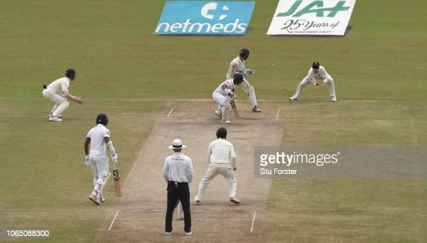 England keeper Ben Foakes looks on as slip catcher Ben Stokes catches Dhanushka Gunathilleke for 6 runs off the bowling of Moeen Ali during Day Three...