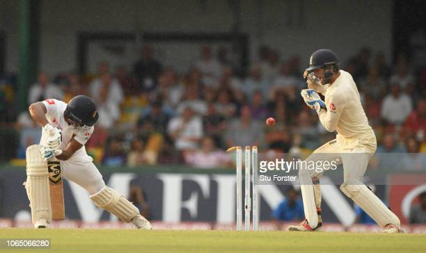 England keeper Ben Foakes reacts as Sri Lanka batsman Dimuth Karunaratne is bowled by Moeen Ali during Day Three of the Third Test match between Sri...