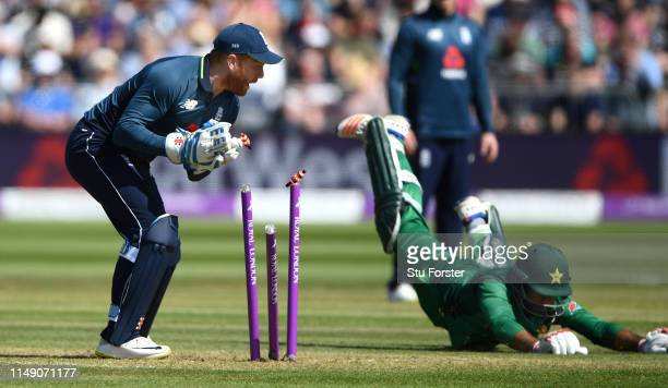 England keeper Jonny Bairstow runs out Pakistan batsman Sarfraz which is given not out after review during the 3rd Royal London ODI match between...