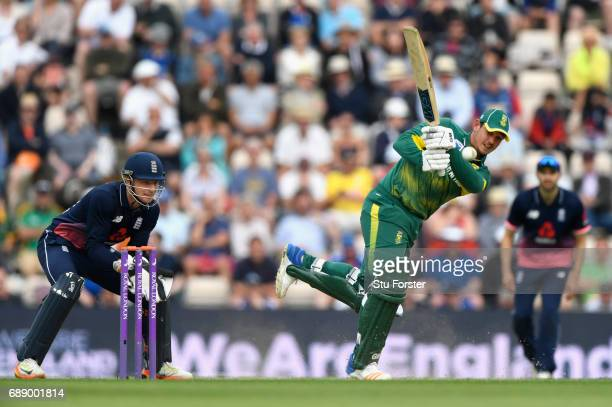 England keeper Jos Buttler looks on as South Africa batsman Quinton de Kock hits a boundary during the 2nd Royal London One Day International between...