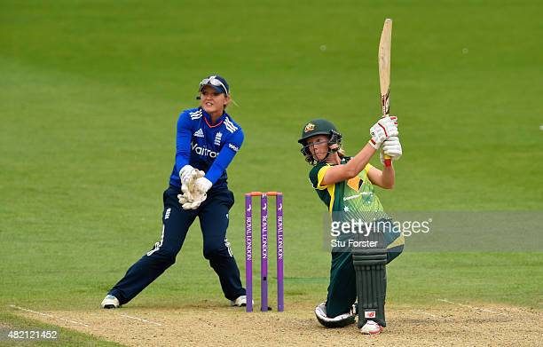 England keeper Sarah Taylor looks on as Australia batsman Meg Lanning hits out during the 3rd Royal London ODI of the Women's Ashes Series between...