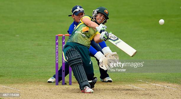England keeper Sarah Taylor looks on as Australia batsman Nicole Bolton hits out during the 3rd Royal London ODI of the Women's Ashes Series between...