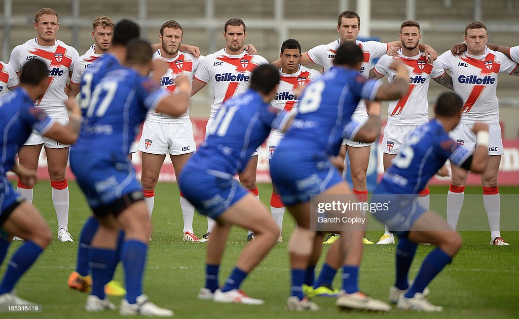 England Knights players watch the Samoan haka ahead of the International match between England Knights and Samoa at Salford City Stadium on October 19, 2013 in Salford, England.