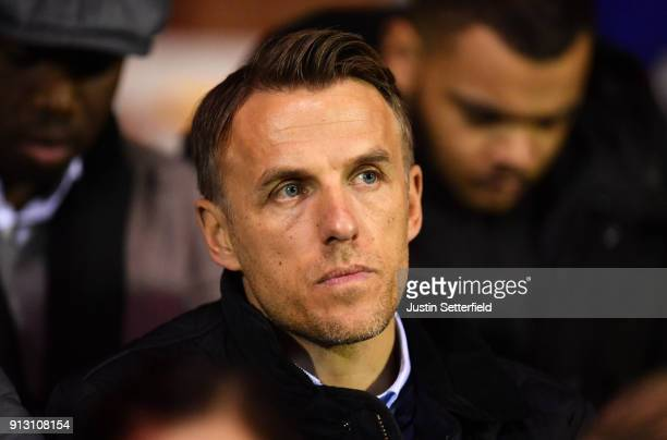 England Ladies Head Coach Phil Neville watches the WSL match between Chelsea Ladies and Manchester City Ladies at The Cherry Red Records Stadium on...