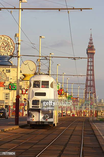 england, lancashire, blackpool a blackpool tram travels along the seafront promenade towards blackpool tower in blackpool, united kingdom - 2007 stock pictures, royalty-free photos & images