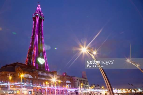 England Lancashire Blackpool Seafront promenade with Tower illuminated at dusk