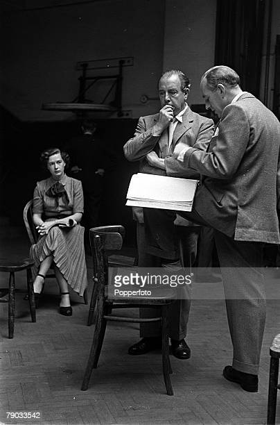 England Legendary British actor Alec Guiness makes a suggestion to playwright and author JB Priestley during reheasals of his play Last Holiday as...