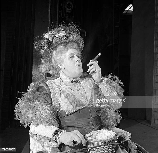 England Legendary British actress Margaret Rutherford is pictured smoking a cigar on the set of the play 'Ring Round the Moon' where she plays the...