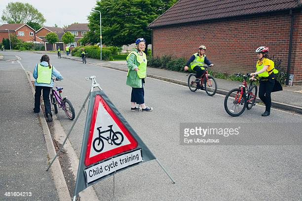 England Lincolnshire School children being taught cycle safety lessons on public roads