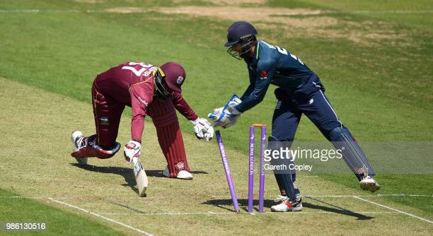 England Lions wicketkeeper Ben Foakes removes the bails to run out Raymon Reifer of West Indies A during the TriSeries International match between...