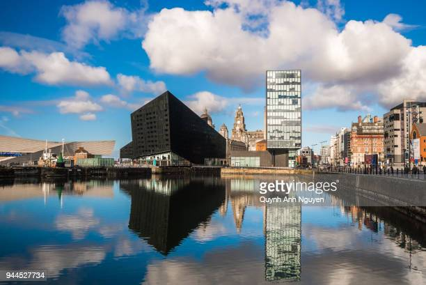 UK, England, Liverpool: Mann Island apartments with Liver Building and lightship and waterfront buildings viewed across Canning Dock