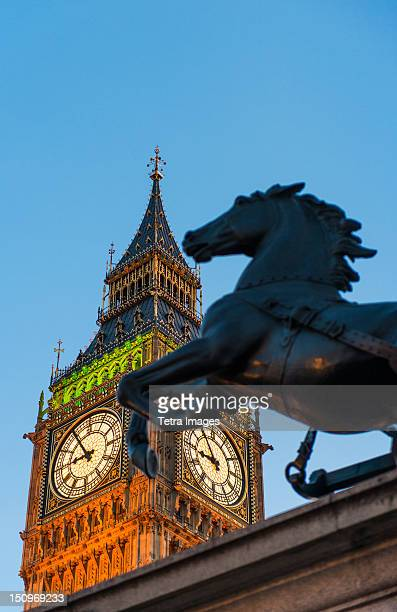 UK, England, London, Big Ben and Boadicea Statue at dusk