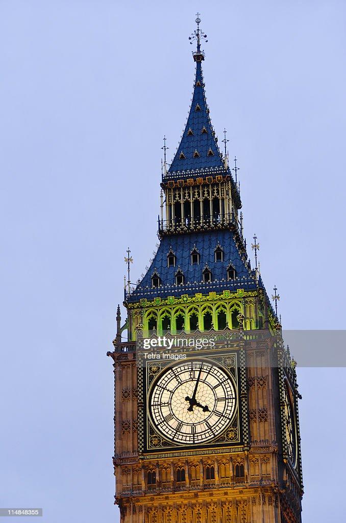 England, London, Big Ben clock face illuminated at dusk : Stock Photo