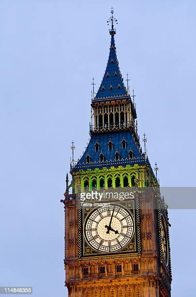 England, London, Big Ben clock face illuminated at dusk